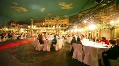 Many people sit at tables in restaurant during banquet Stock Footage