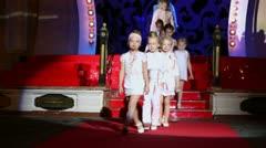 Little girls walk runway during children fashion show Stillini Stock Footage