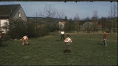 Vintage 8 mm film: Family playing ball Stock Footage