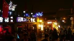 Crowd pedestrian people Walk on China Beijing night market.Neon shop Timelapse. Stock Footage