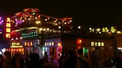 Crowd pedestrian people Walk on China Beijing bar market.Neon shop Timelapse. Stock Footage