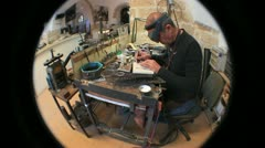 740 mature silversmith working on a piece of jewelry - stock footage