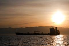 bulk-carrier ship at sunset - stock photo