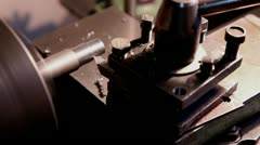 worker handles metal piece on the lathe 3 - stock footage