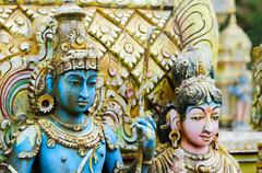 Stock Photo of shiva with his  wife parvati on traditional hindu temple