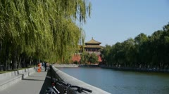 Chinese ancient buildings tower & willow relying on river in Beijing. Stock Footage