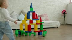 Child destroys house of colored blocks. Concept. Stock Footage