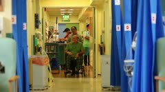 Patient in wheelchair on hospital ward - stock footage