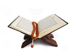 koran, the holy islamic book isolated - stock photo