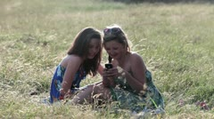 Teenage girls looking at smartphone - stock footage