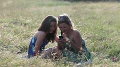 Teenage girls looking at smartphone Stock Footage