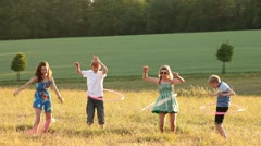 Stock Video Footage of Teenagers hoola hooping
