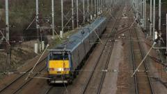 Electric powered train on track Stock Footage