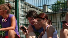 Group of teenagers looking at smart phone Stock Footage
