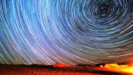 Stock Video Footage of Spectacular Star Trails Timelapse Space Spin Over Desert