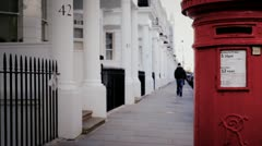 Post box and sidewalk in Gloucester Road, London Stock Footage