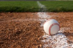 baseball on the chalk line - stock photo