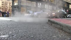 Curb, steam manhole Stock Footage