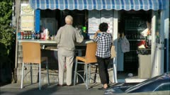 Couple at snackbar order from menu Stock Footage