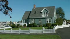 Seaside Cottage white pickett fence - stock footage