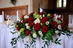 Red roses decorate wedding table Stock Photos