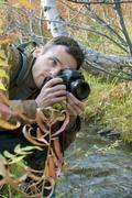 man was inclined over a stream - stock photo