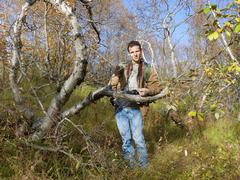 young man in foothills - stock photo