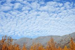 sky over mountainous country - stock photo