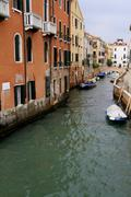 Travel Italy: vertical Venetian street channel view Stock Photos