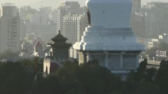 Panoramic view of BeiJing BeiHai Park White Tower & metropolis high rise. Stock Footage