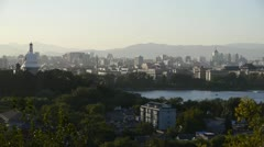 Panoramic view of BeiJing BeiHai Park White Tower & metropolis high rise. Stock Footage