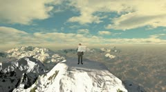 Lost Businessman with Map on top of the mountain above clouds Stock Footage