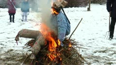 Burning a straw doll on a funeral pyre for driving out the winter - stock footage