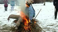 Burning a straw doll on a funeral pyre for driving out the winter Stock Footage