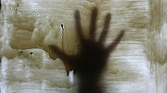 White glass and hand in motion - stock footage