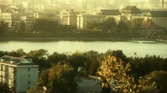 panoramic view of BeiJing BeiHai Park & flock of white pigeons on lake. - stock footage