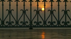 Sunset through a bandstand - stock footage