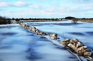 Stonewall at ice covered flood Stock Photos