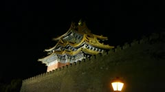 Panoramic of Beijing Forbidden City turret & street lights in night. - stock footage
