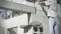 Construction Worker Builds a Masonry Wall - stock footage