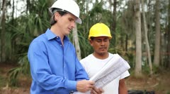 Homebuilder and Construction Worker Review Plans Stock Footage