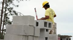 A Construction Worker Building a Masonry Wall Stock Footage