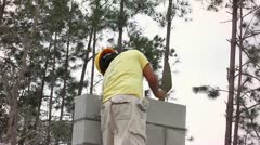 A Construction Worker Builds a Masonry Wall - stock footage