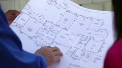Closeup of Architectural Plans at Construction Site Stock Footage