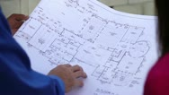 Stock Video Footage of Closeup of Architectural Plans at Construction Site