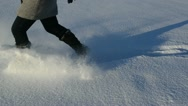 Woman legs winter shoes run fluffy snow cold sunny day Stock Footage