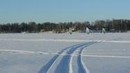 Three people ice sailing boats winter frozen lake seasonal sport Stock Footage