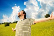 Happy succesful man in nature with wide open arms Stock Photos