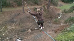 Stock Footage Unidentifiable Woman on Slackline then falls Video 1080 HD Stock Footage