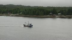 Fishing Boat passes through Ketchikan, Alaska Stock Footage